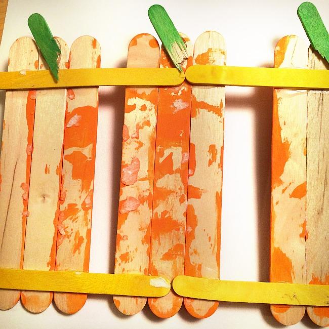 pumpkins on a fence crafts for kids