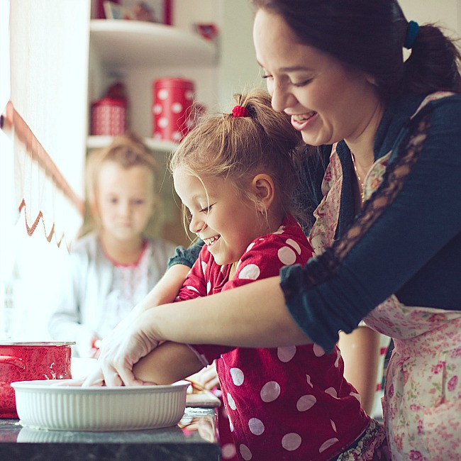 mom cooking with girl